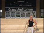 Christine standing in front of awards auditorium