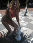 Christine about to move a chess piece the size of a fire hydrate.