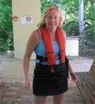 Christine in light blue T, black skirt and orange life preserver - Helo ready
