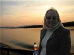 Christine in white turtleneck and jacket on te Irun Bru