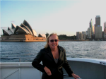 Christine in leather jacket and sunglasses on a boat in Australia